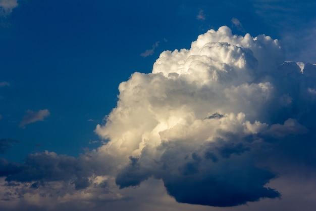 A huge cumulus cloud in the blue sky