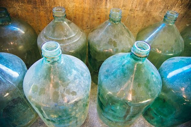 Huge glass bottles for wine.