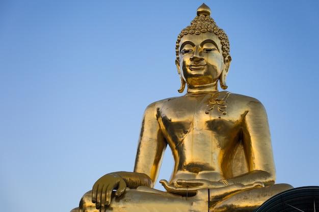 Huge golden buddha sculpture