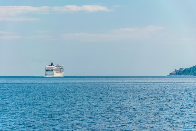 A huge liner with tourists went to the open sea.