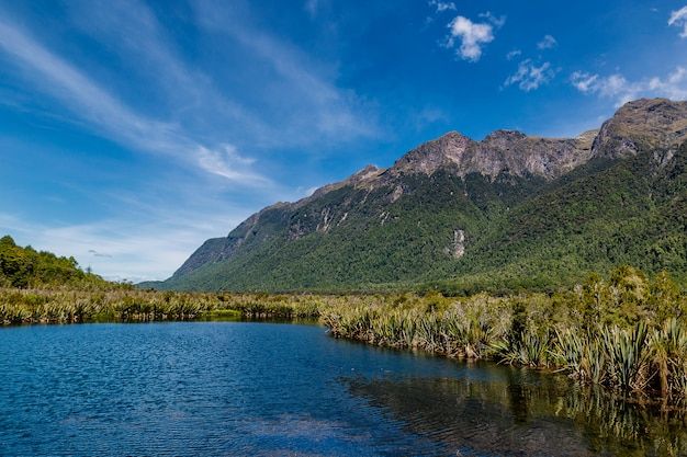 Huge mountains and lake in fjordland national park in new zealand
