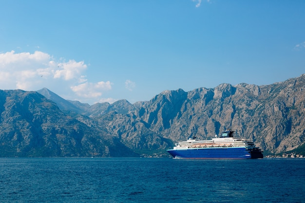 A huge multi-deck cruise liner in kotor bay