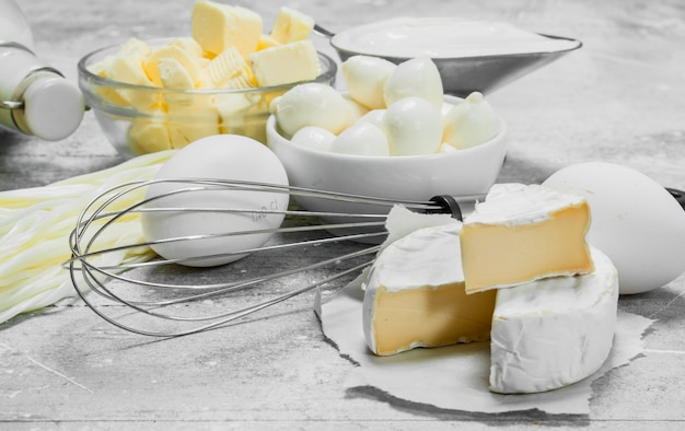 Huge range of dairy products. on a rustic table.