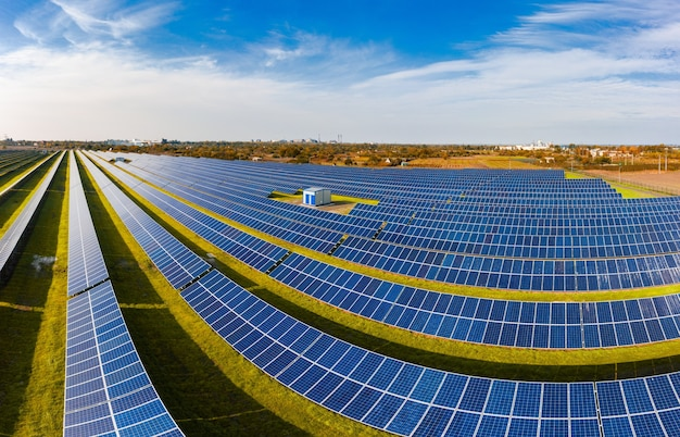 Huge solar power plant to use solar energy in a picturesque green field