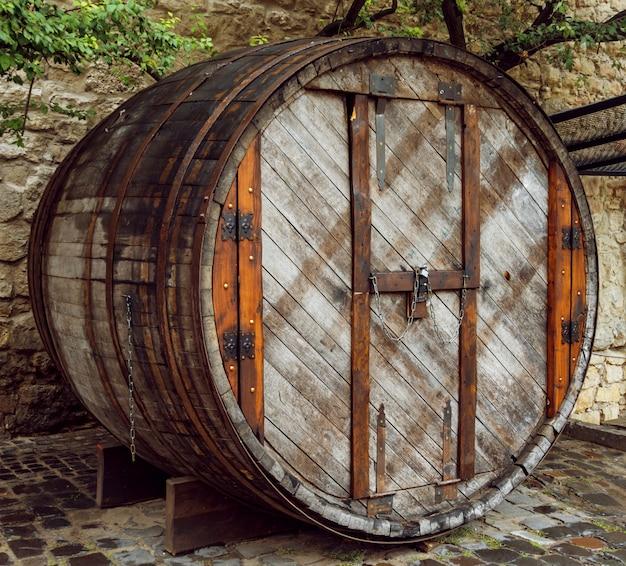 A huge wooden barrel with a door
