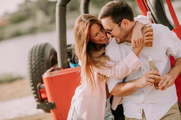 Hugged young couple outside