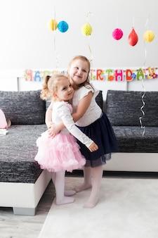 Hugging girls on birthday party