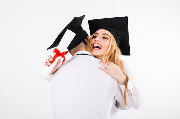 Hugging graduating couple