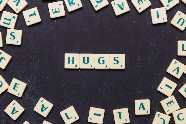 Hugs text arranged in a row over black background