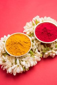 Huldi kumkum with jasmin flower garland or gajra, selective focus