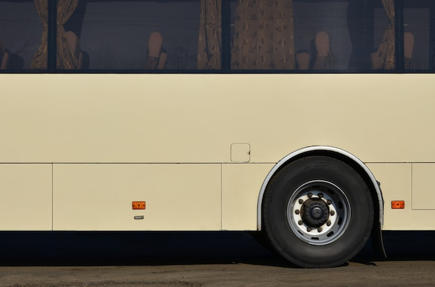 Hull of a large and long yellow bus with free space