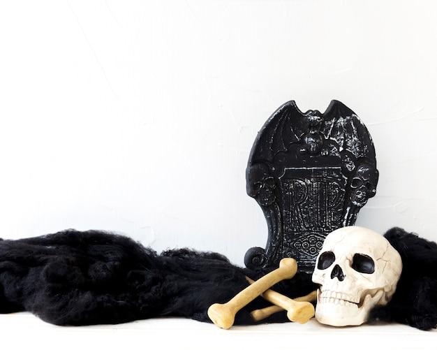 Human bones near tombstone