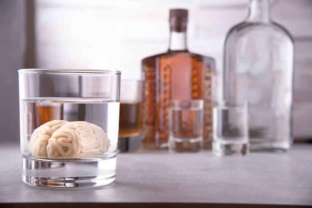 Human brain in a glass with an alcoholic drink