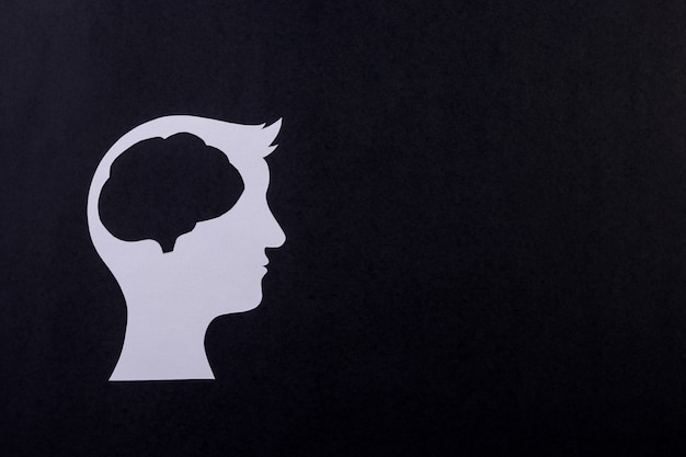 Human brain made from paper cut on black background. creativity or smart idea concept.