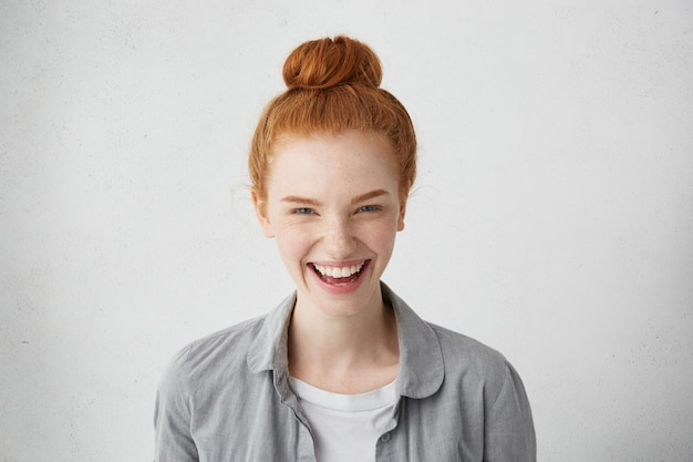 Human facial expressions, emotions, feelings, reaction and attitude. cheerful redhead european girl with freckles laughing happily