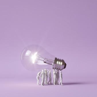 Human figurines carrying lit lightbulb as an idea concept