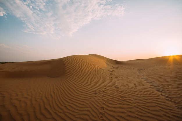 Human footprints in the sand in the desert