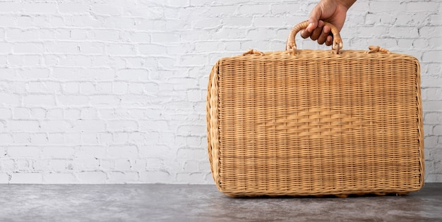 Human hand hold wooden bag