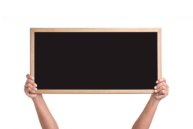 Human hand holding blackboard with wooden frame isolated on white