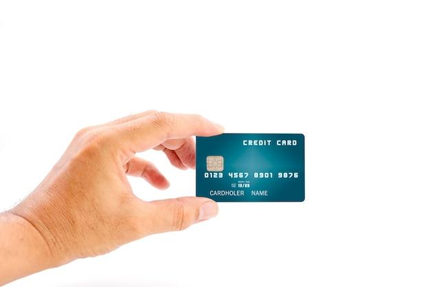 白い背景の上の青い色の銀行のクレジットカードを保持している人間の手、ビジネスや金融の概念に使用します。