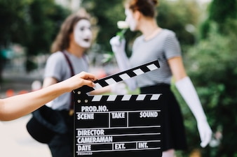 Human hand holding clapperboard