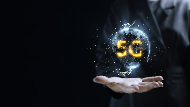 Human hand holding earth 5g globe holographic technology . futuristic visualization for virtual reality and augmented reality . empty space for your text.