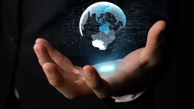 Человеческая рука держит голографическую технологию земного шара