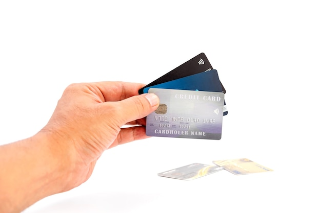 白い背景の上の銀行のクレジットカードの人間の手持ちグループ、ビジネスと金融の概念に使用します。