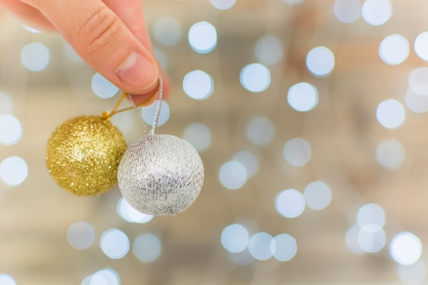 Human hand holding ornament baubles