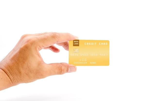 白い背景に黄色の銀行のクレジットカードを保持している人間の手、ビジネスや金融の概念に使用します。