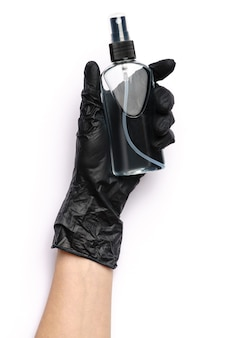 Human hand in protective glove holding alcohol hand sanitizer spray