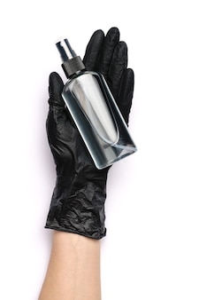 Human hand in protective glove holding alcohol hand sanitizer
