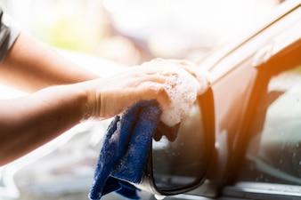 Human hand showing cleaning car