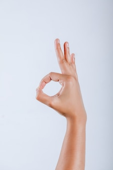 Human hand showing ok gesture