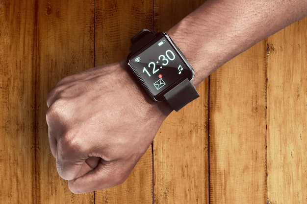 Human hand wearing smart watch