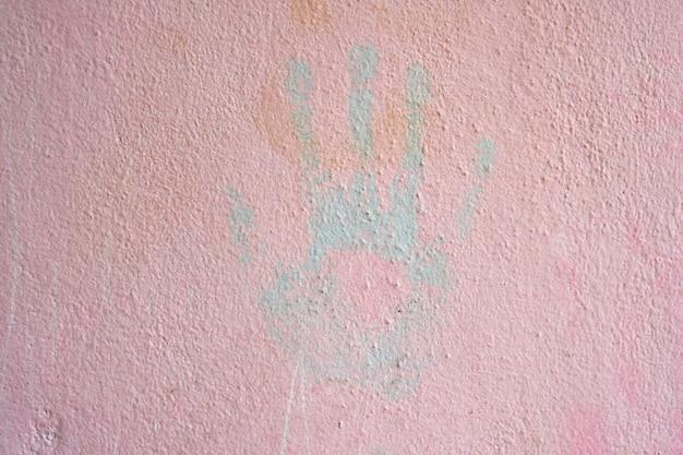 Human handprints on cement floor