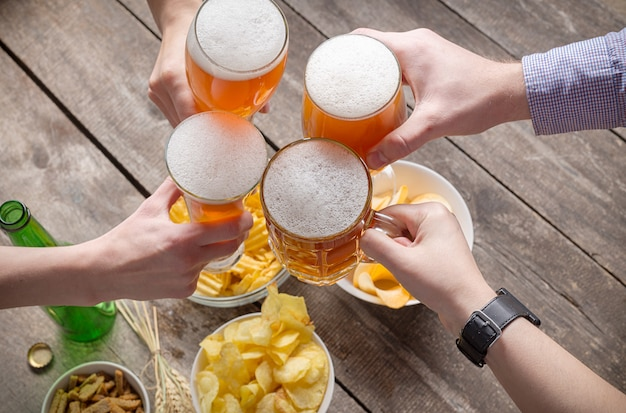 Human hands and glasses of beer