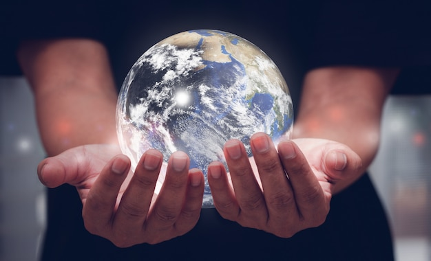 Human hands holding blue earth. elements of this image furnished by nasa