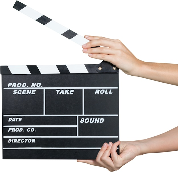 Human hands holding a movie clapboard - isolated