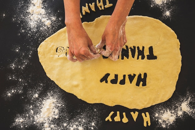 Human hands molding dough