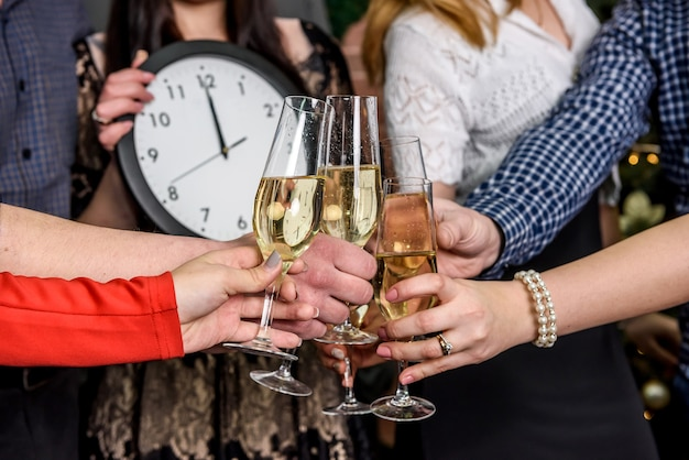 Human hands with glasses of champagne close up