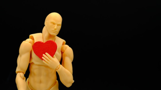 A human model and a wooden red heart