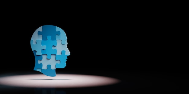 Human puzzle head shape in the spotlight isolated