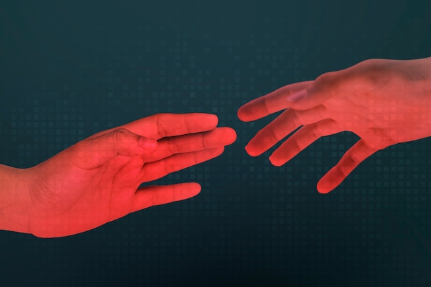 Human red hands reaching for each other