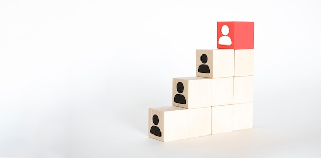 Human resources and talent management and recruitment business concept, hand putting wood cube block on top staircase, copy space