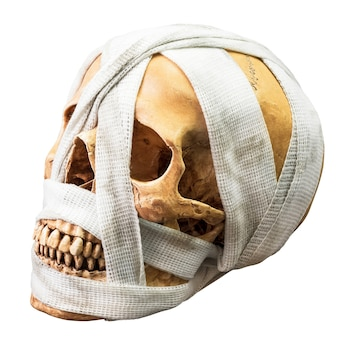 Human skull bind with dirty bandage isolated on white background