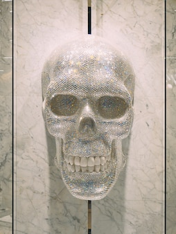 Human skull made of crystals elements of decor in the clothing
