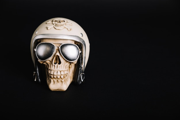 Human skull wearing helmet and sunglasses