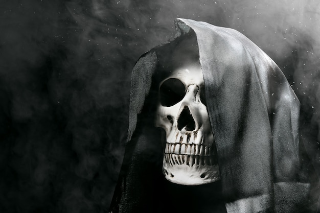 Human skull with a black cloak