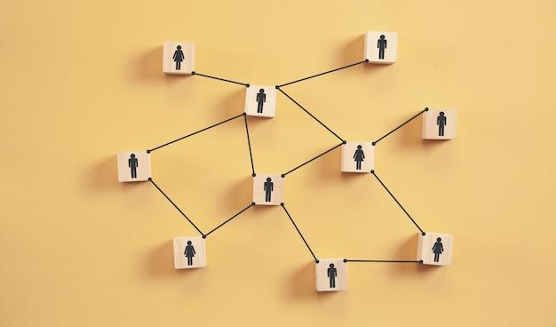 Human social network. human figures on wooden cubes